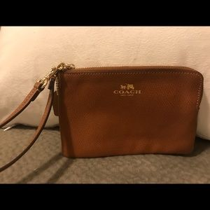 Coach tan leather wristlet.